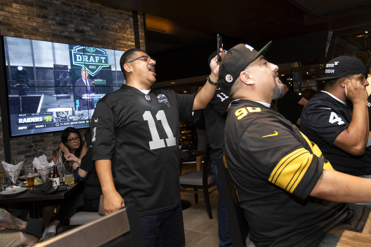 Frank Zacarias, left, and Edward Hernandez react as the Raiders announce Alabama offensive tack ...