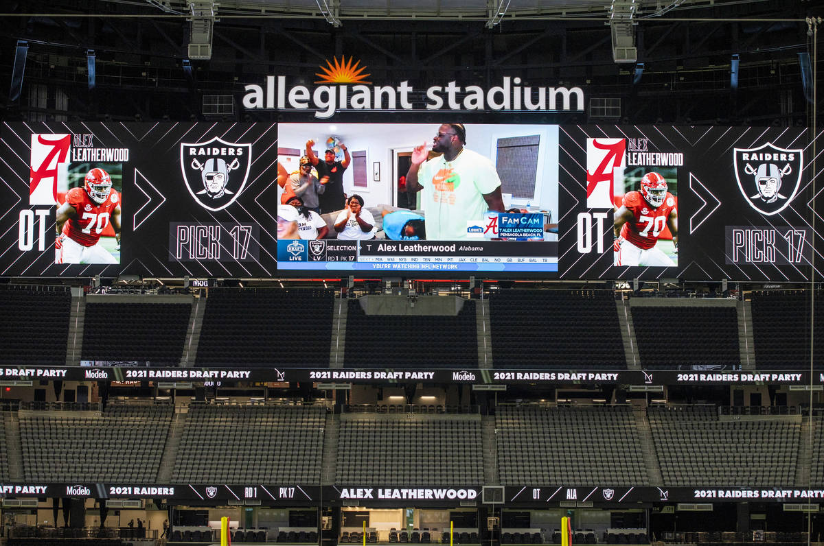 Alex Leatherwood of Alabama is shown on the screen while announced as the teamÕs first rou ...