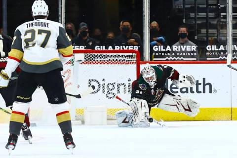 Arizona Coyotes goaltender Adin Hill (31) blocks a shot from the Golden Knights during the seco ...