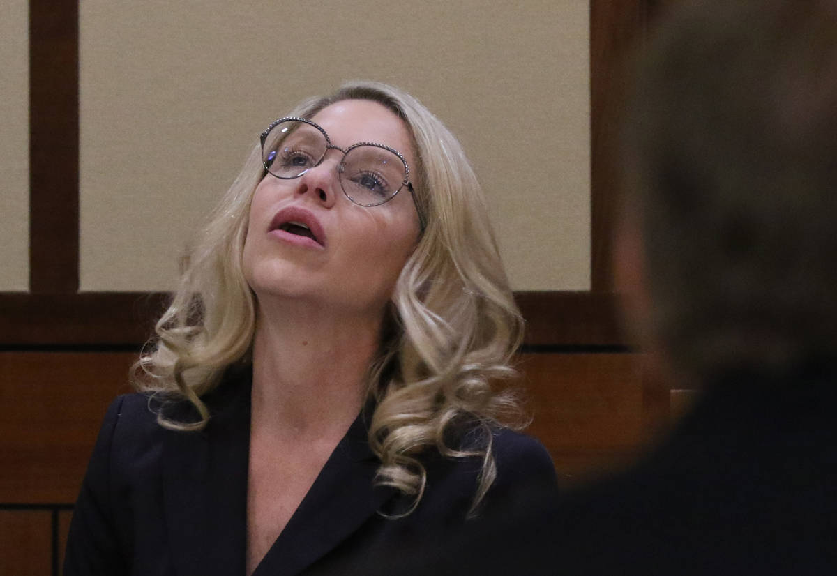 Justices of the Peace Melanie Andress-Tobiasson, left, pauses as she answers Prosecutor Thomas ...