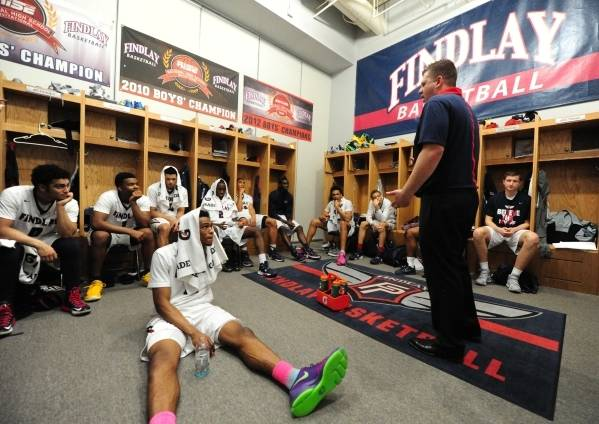 Findlay Prep coach Andy Johnson addresses his team during halftime of their game against Las Ve ...