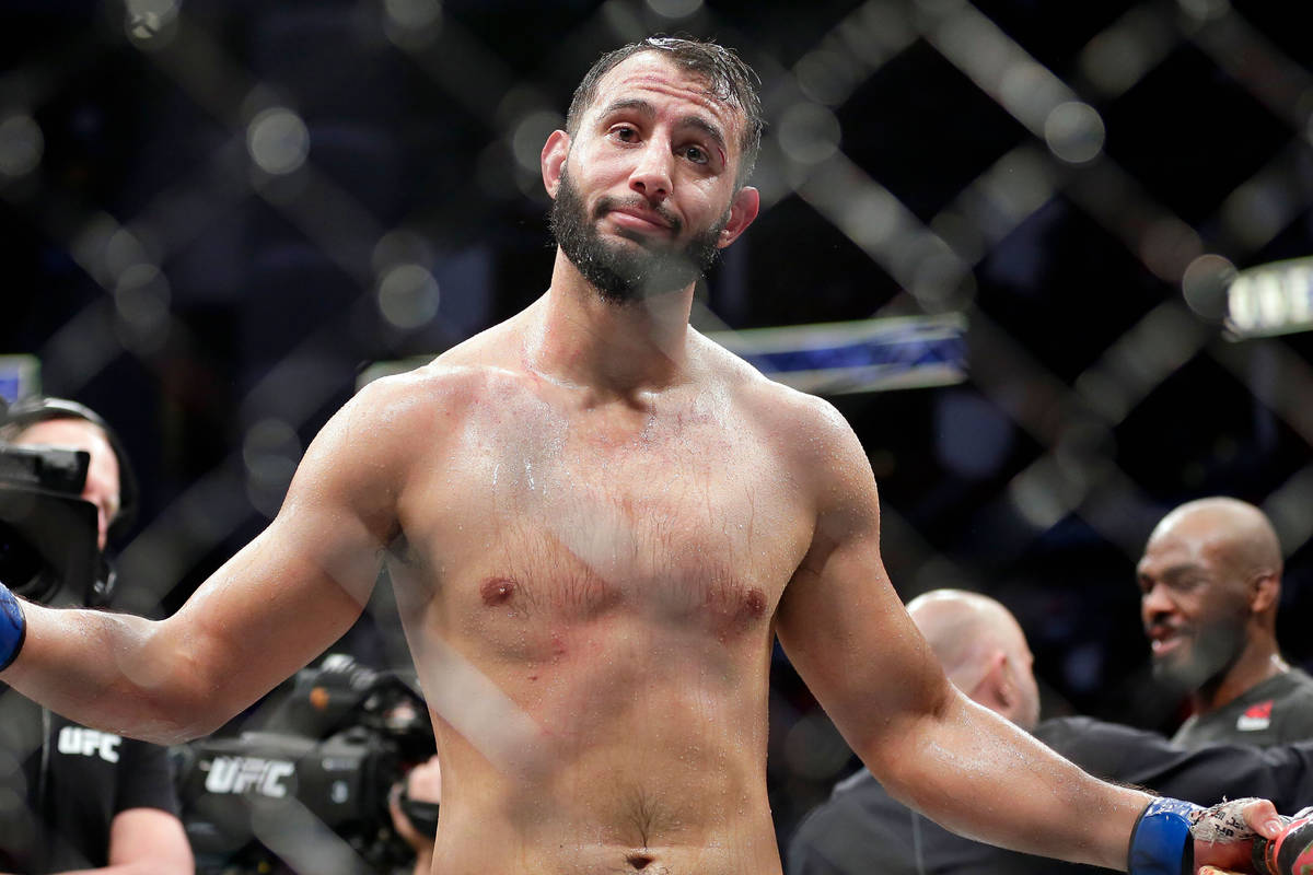 Dominick Reyes reacts as he walks away after his opponent Jon Jones, right, was named the winne ...