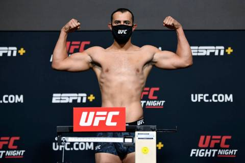 Dominick Reyes poses on the scale during the UFC weigh-in at UFC APEX on April 30, 2021 in Las ...