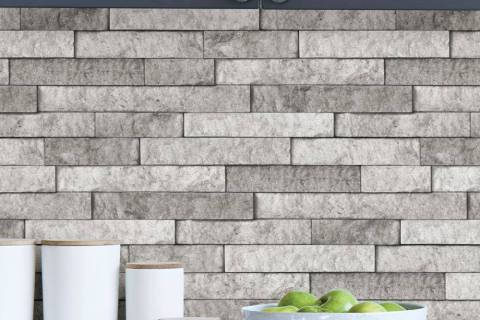 Split gray peel-and-stick natural stone tile gives an elegant look to any space. (Lowes)
