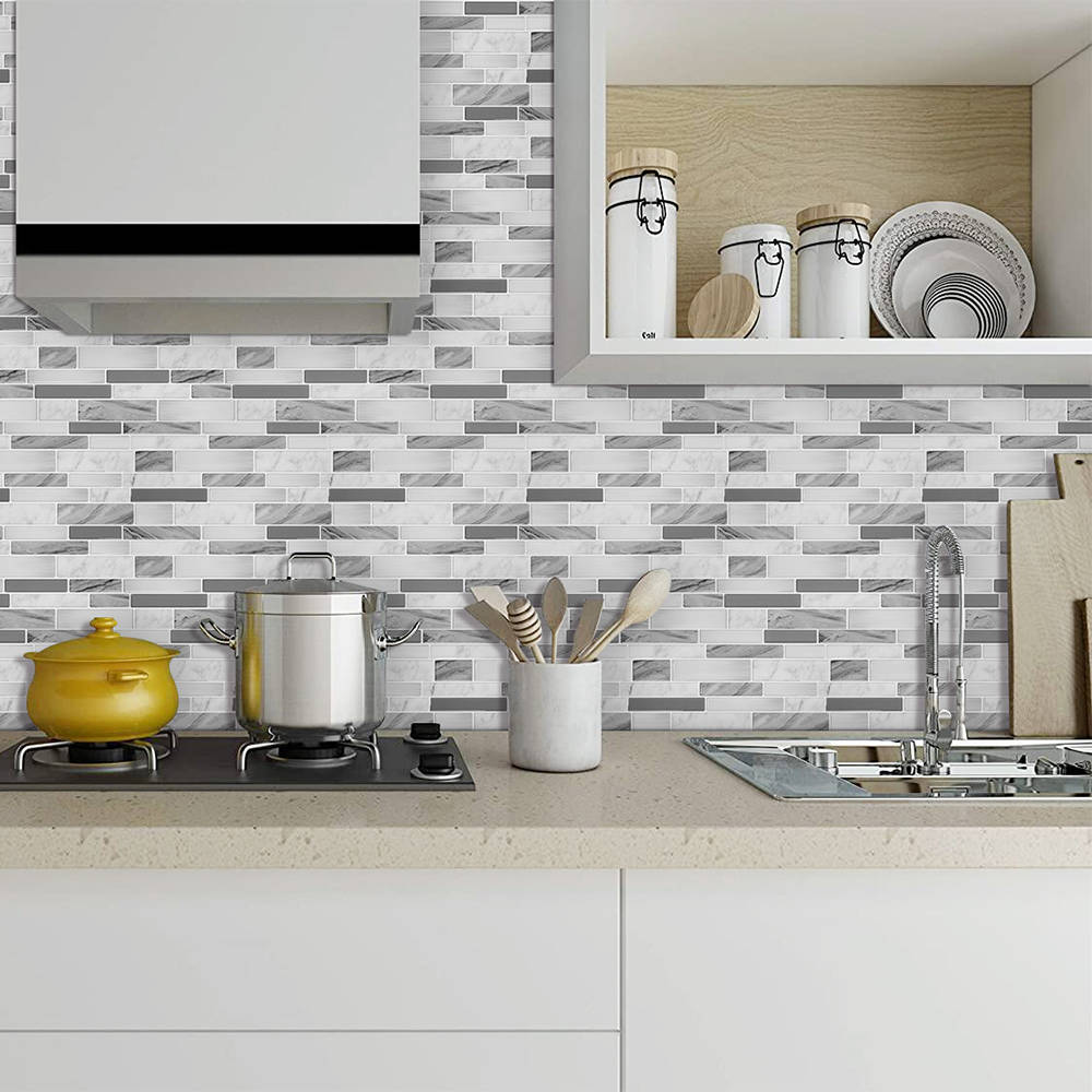 Stickgoo peel-and-stick tiles are resistant to heat and moisture. They are widely used on kitch ...