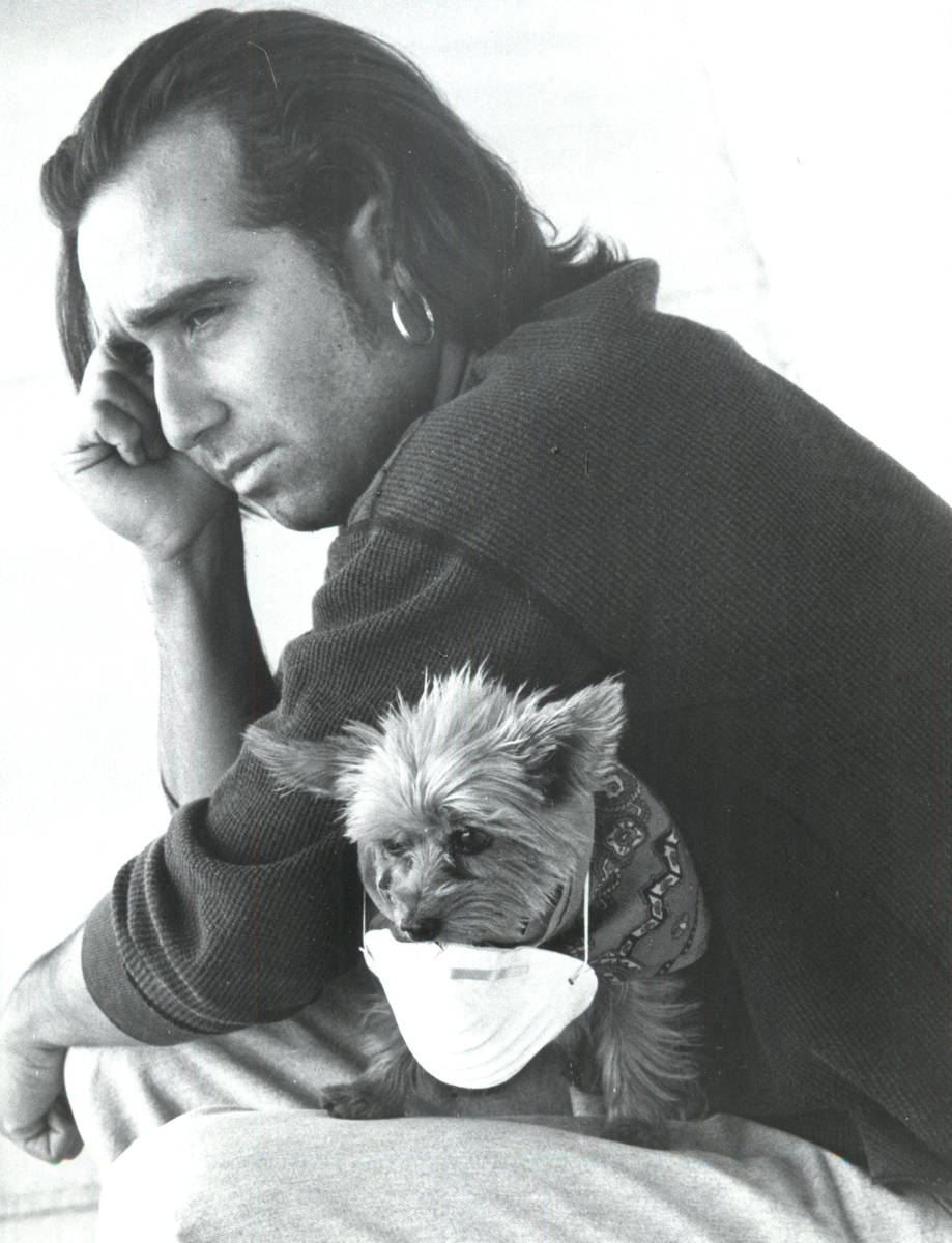 Mark Freeze and his dog, Jajmin, sit outside outside Helen C. Cannon Junior High School on May ...
