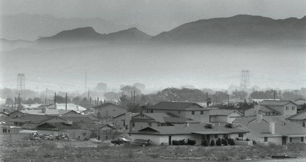 A cloud hovers over Henderson after the Pioneer Chlor Alkali Co. chlorine leak on May 6, 1991. ...