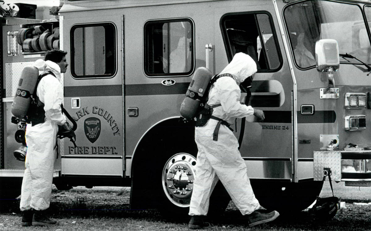 Firefighters don protective gear at the Pioneer Chlor Alkali leak on May 6, 1991, in Henderson. ...