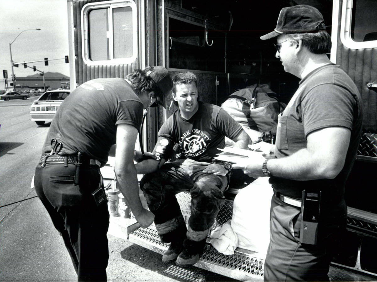 Firefighter Kevin Steele (center) has his pulse checked May 6, 1991, after a chlorine leak in H ...
