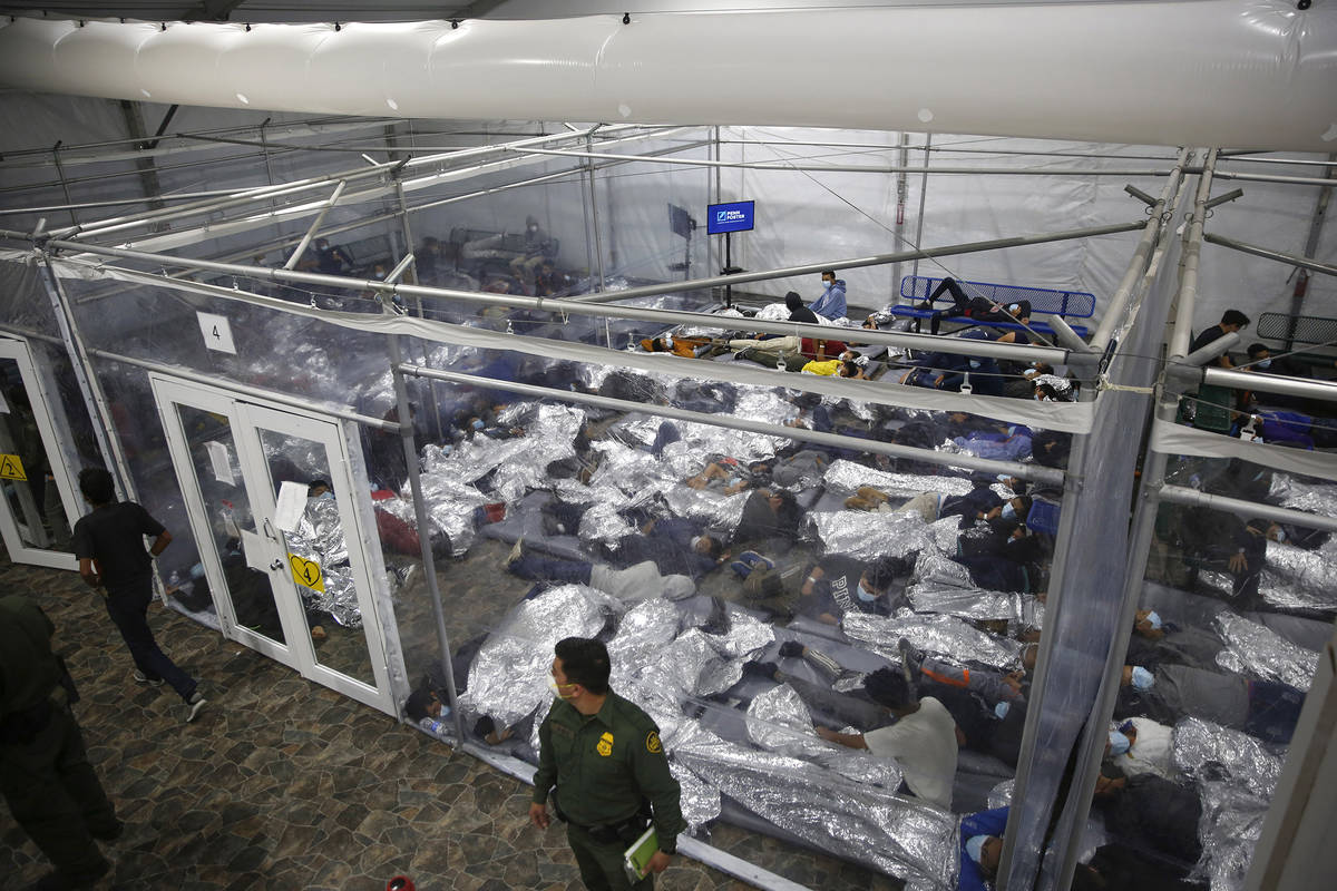 FILE - In this March 30, 2021, file photo, minors inside a pod at the Donna Department of Homel ...
