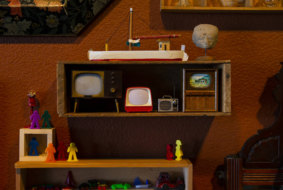 Collected miniature TVs and other items are displayed at the Office of Collecting & Design, ...