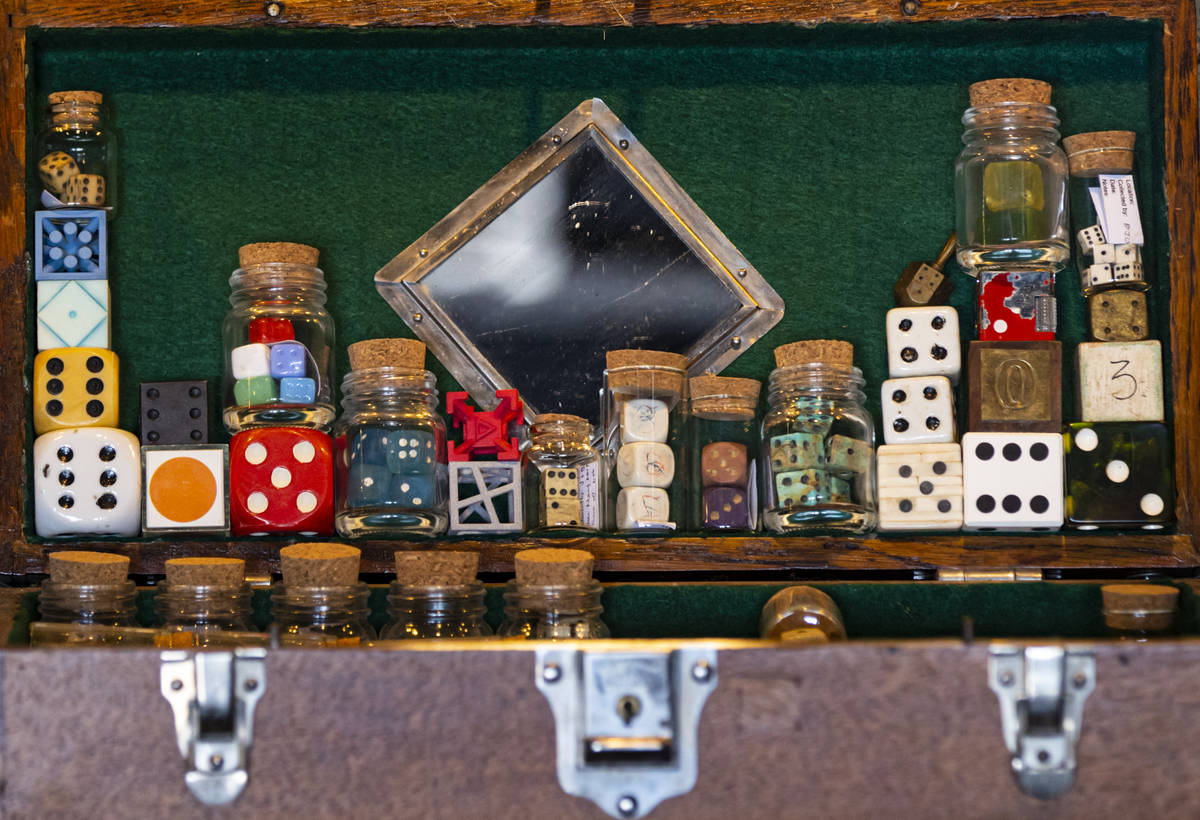 A collection of damaged and altered dice is displayed at the Office of Collecting & Design, ...