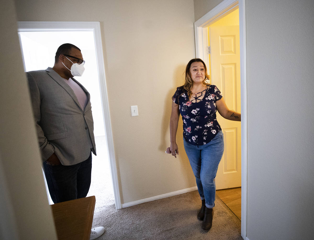 Realtor Cassidy Cotten, left, shows a home to first-time homebuyer Amy Phinsee, right, at a hom ...