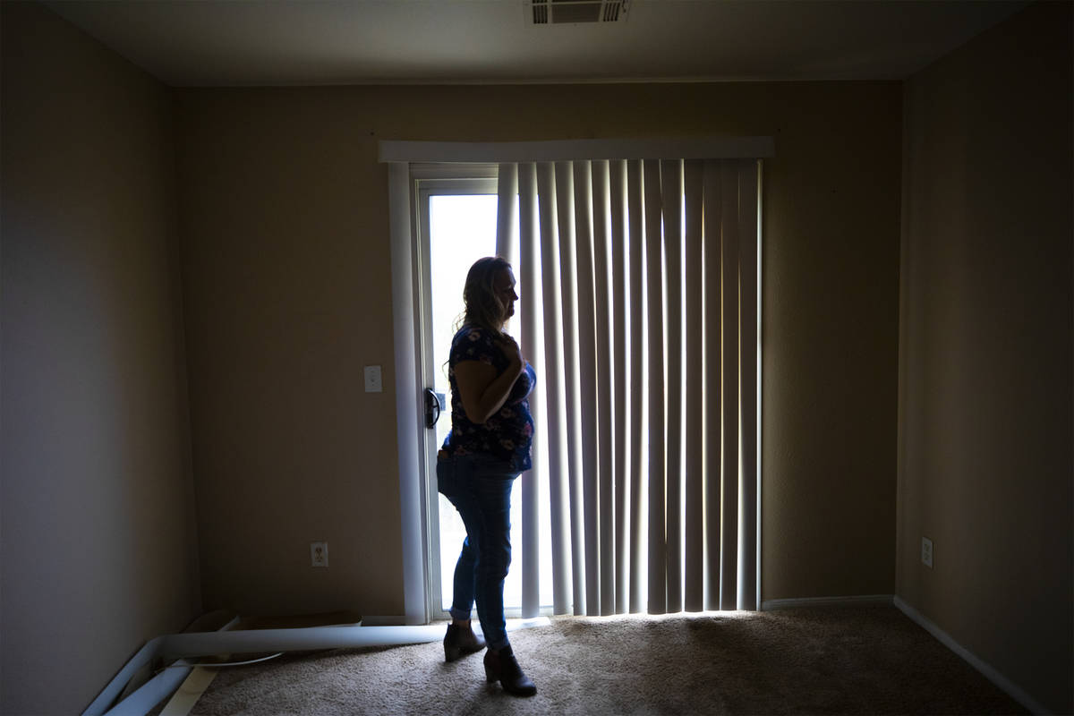 First-time homebuyer Amy Phinsee looks through a home for sale in the northeast part of Las Veg ...