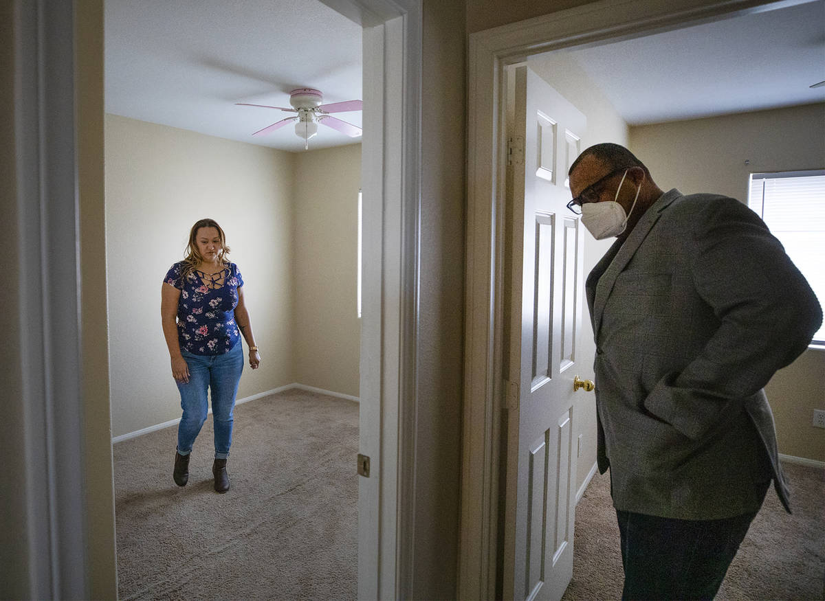 Realtor Cassidy Cotten, right, shows a home to first-time homebuyer Amy Phinsee, left, at a hom ...
