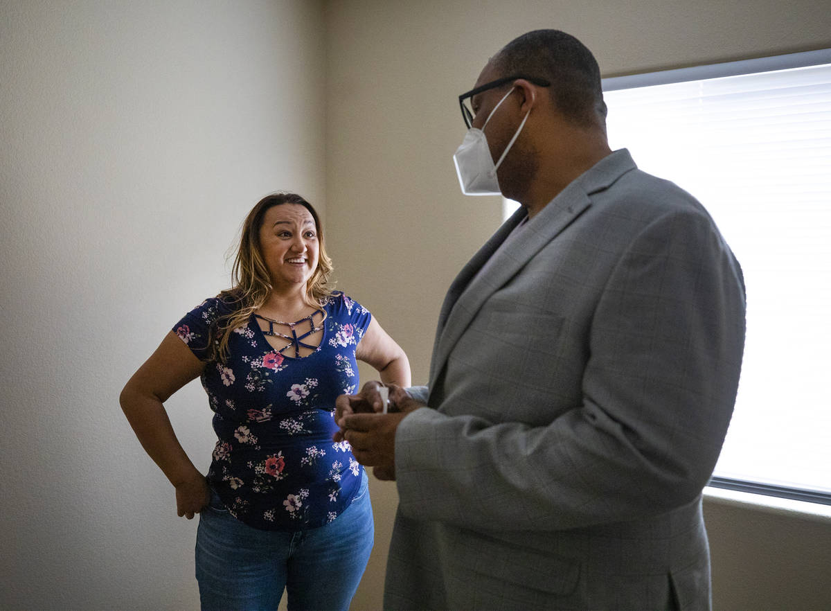 First-time homebuyer Amy Phinsee, left, listens to realtor Cassidy Cotten, right, at a showing ...