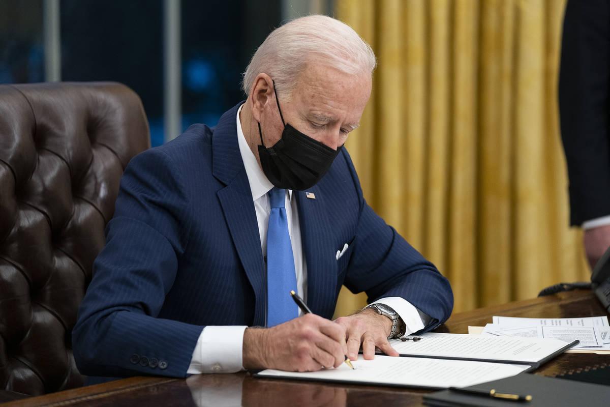 President Joe Biden signs an executive order. (AP Photo/Evan Vucci, File)