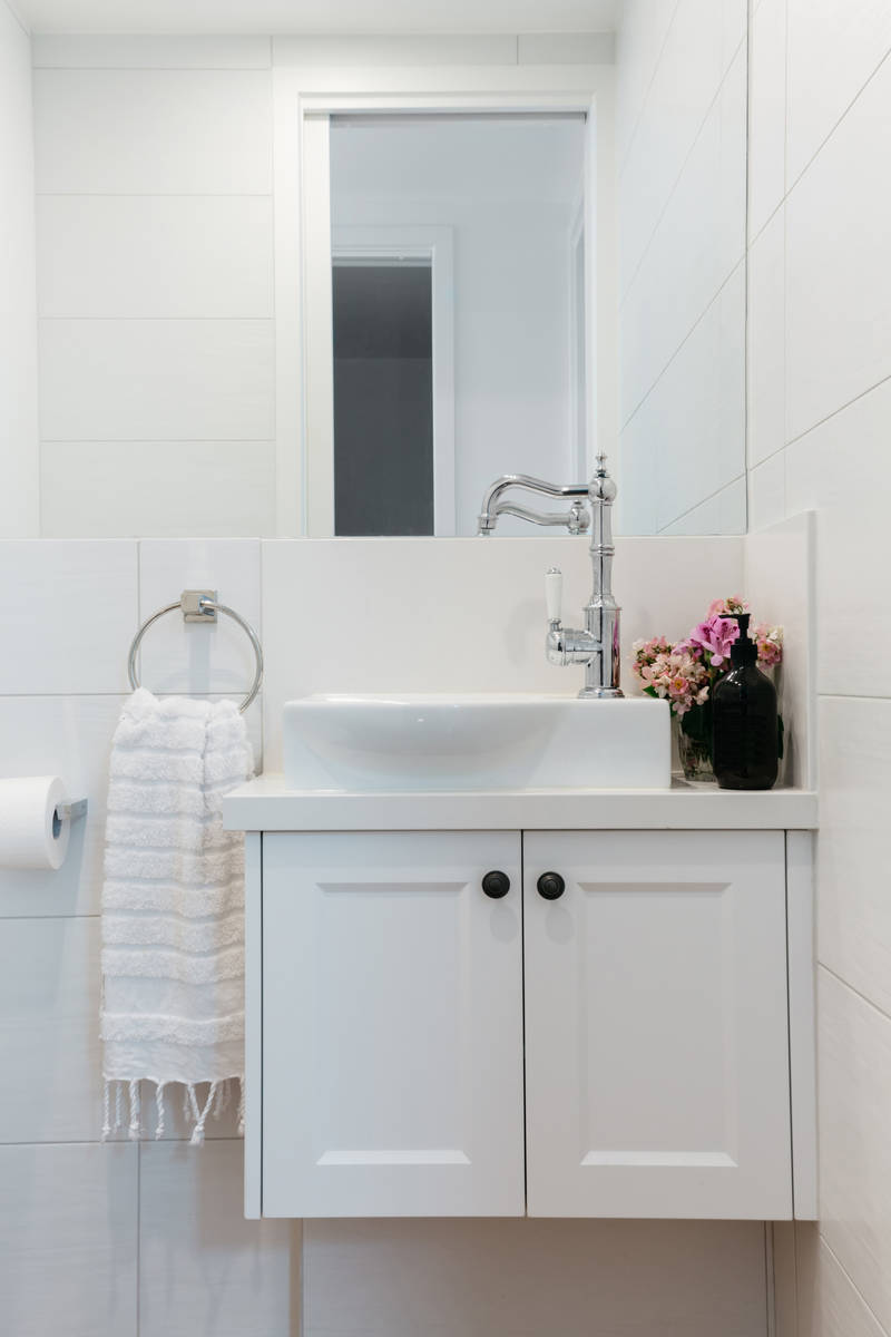 A powder room near the home's entrance provides easy hand-washing access for visitors. (Getty I ...