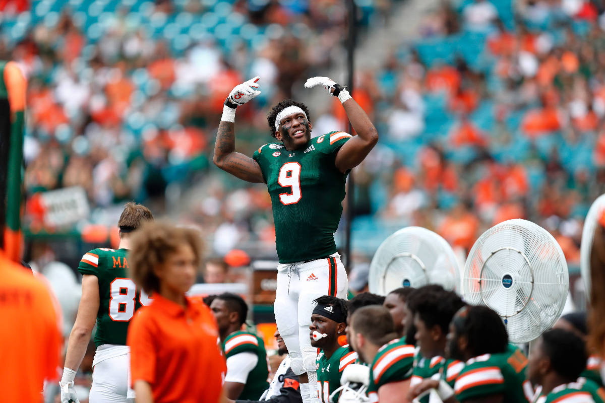 Miami tight end Brevin Jordan (9) encourages the crowd to cheer during the first half of an NCA ...