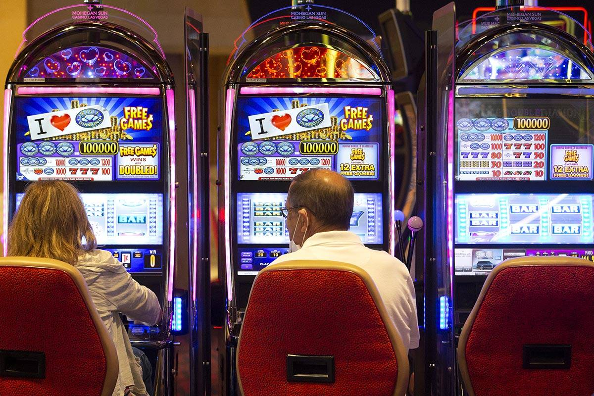 Guests gamble at the Mohegan Sun Casino at Virgin Hotels Las Vegas on Friday, April 30, 2021, i ...
