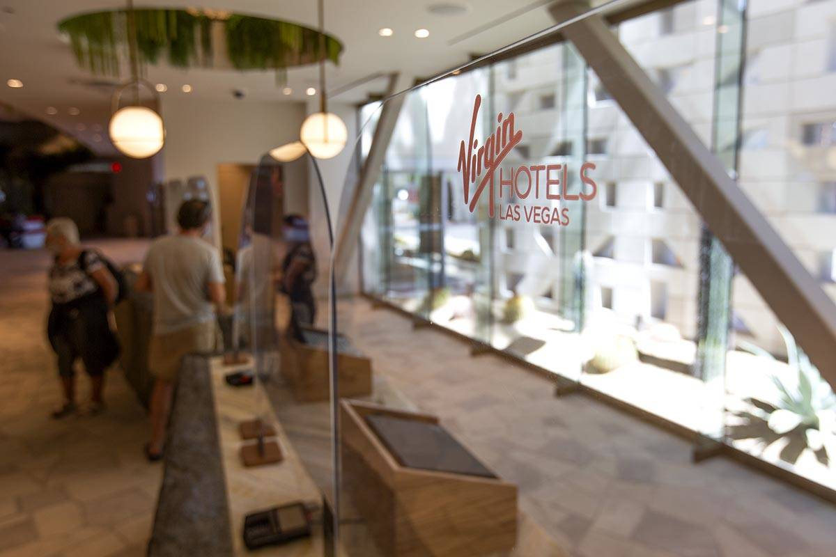 Guests check in at Virgin Hotels Las Vegas on Friday, April 30, 2021, in Las Vegas. (Ellen Schm ...