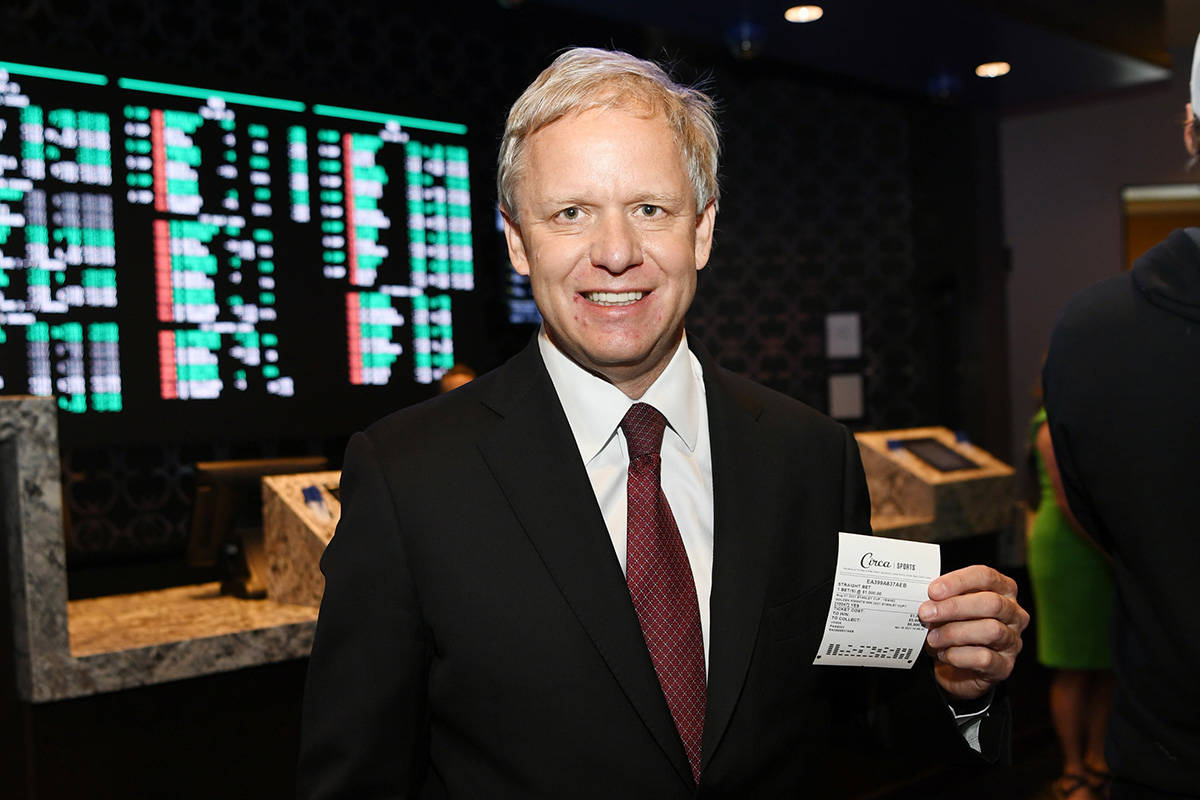 Owner of The Pass Casino Joe DeSimone places first bet during the grand opening of Derek Steven ...