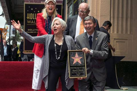 Actress Olympia Dukakis second from left, reacts as she is honored with a star on the Hollywood ...