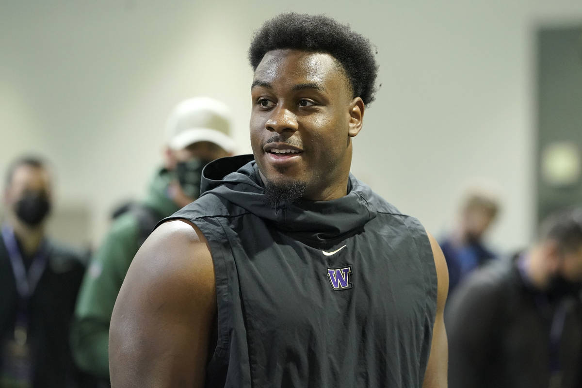 Levi Onwuzurike, a defensive tackle, stands on the field, Tuesday, March 30, 2021, at the start ...