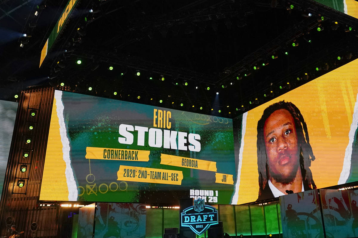 Images of Georgia cornerback Eric Stokes are displayed on stage after he was chosen with by the ...