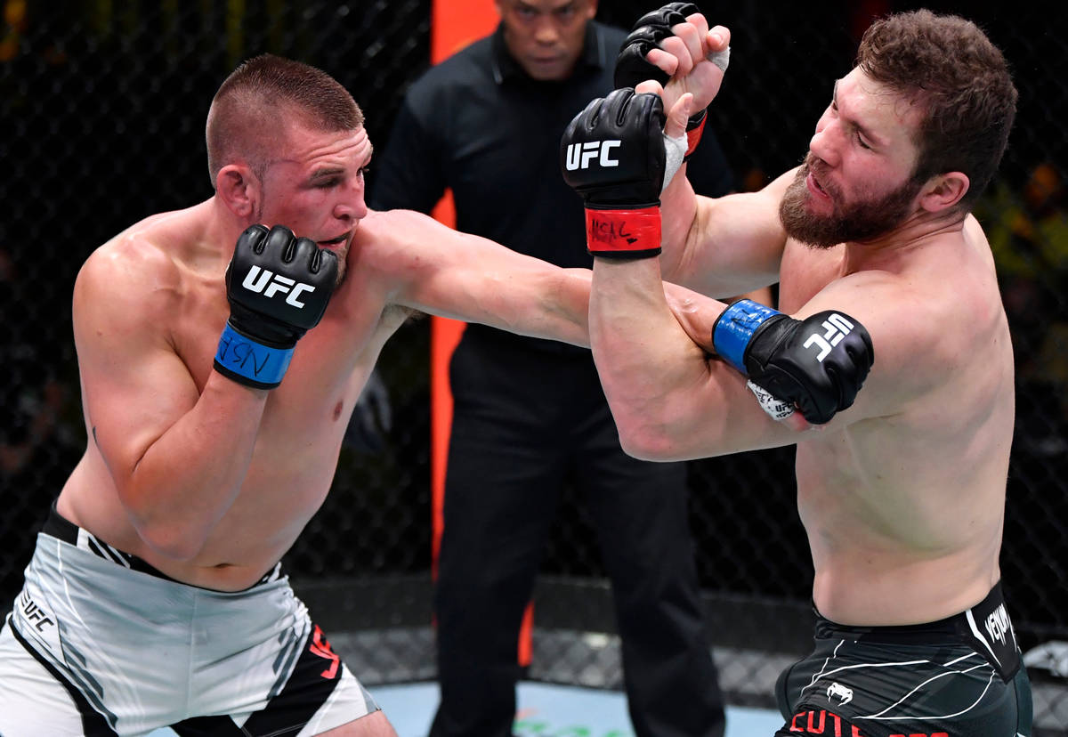 Dustin Jacoby punches Ion Cutelaba of Moldova in a light heavyweight bout during the UFC Fight ...