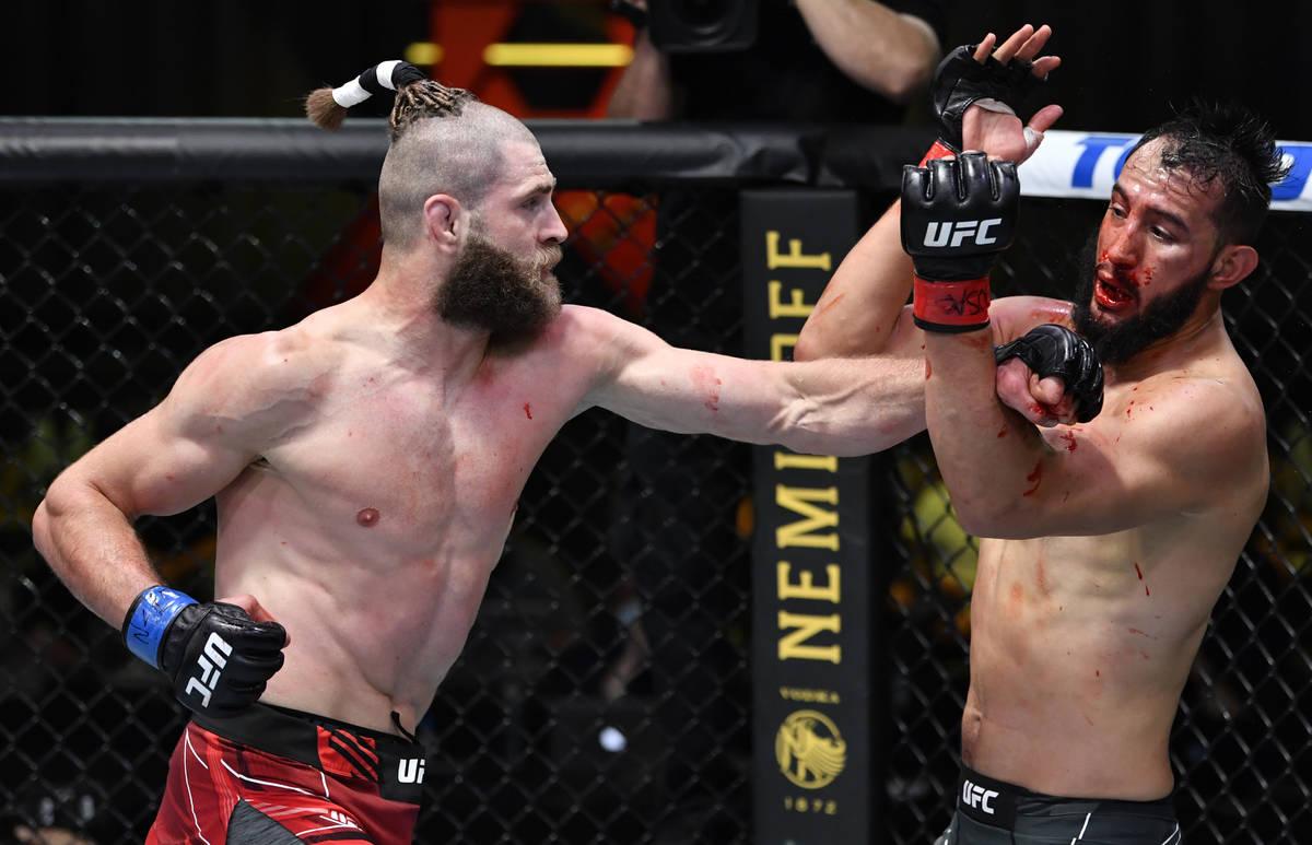 Jiri Prochazka of the Czech Republic, left, punches Dominick Reyes in a light heavyweight bout ...