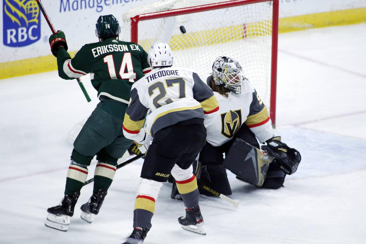 Minnesota Wild center Joel Eriksson Ek (14) scores a goal on Vegas Golden Knights goaltender Ro ...