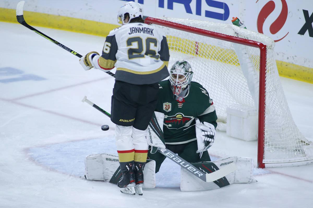 Minnesota Wild goaltender Cam Talbot (33) is blocked by Vegas Golden Knights center Mattias Jan ...