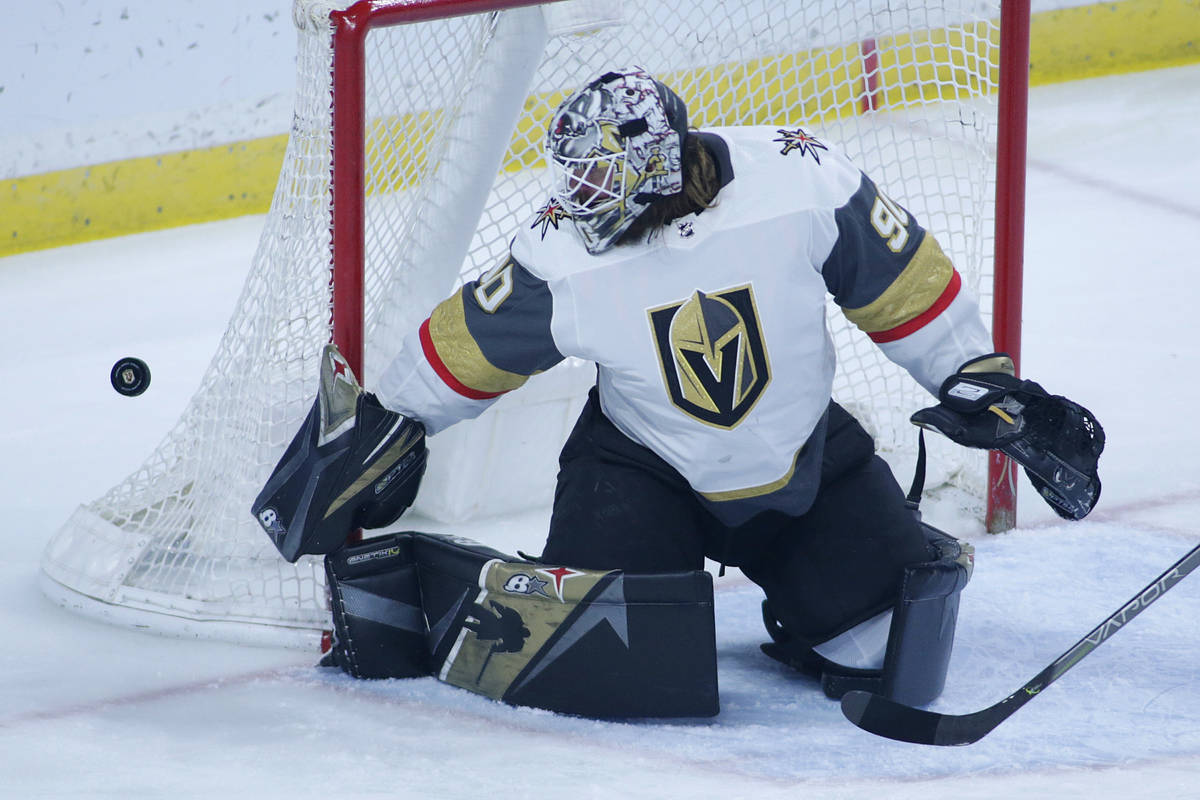 Vegas Golden Knights goaltender Robin Lehner makes a save without a stick against the Minnesota ...