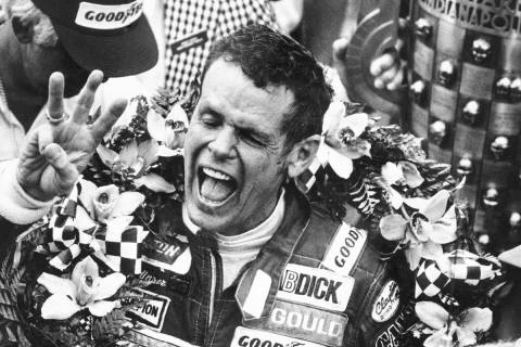 In this May 24, 1981, file photo, Bobby Unser holds three fingers aloft after winning his third ...