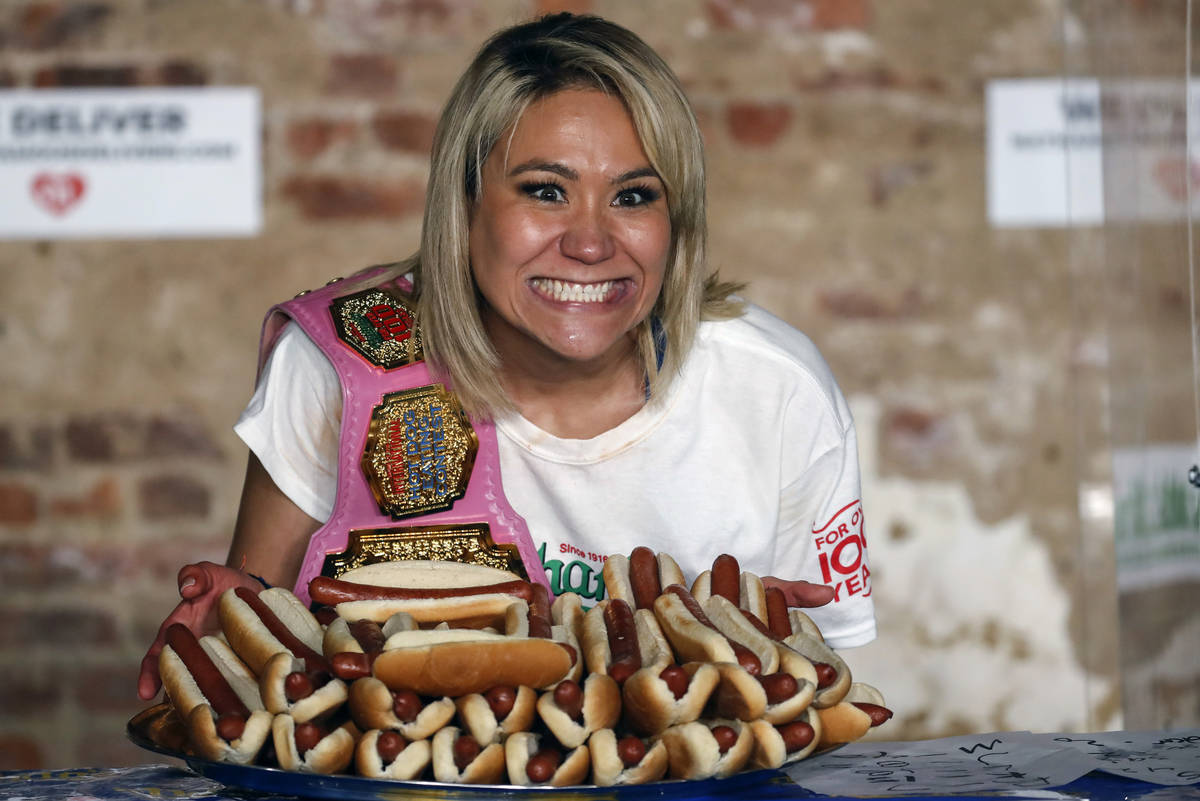 Competitive eater Miki Sudo celebrates after setting the women's world record of 48 and a half ...