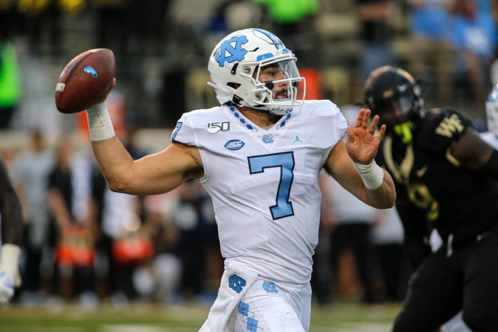 North Carolina quarterback Sam Howell (7) passes against Wake Forest in an NCAA college footbal ...