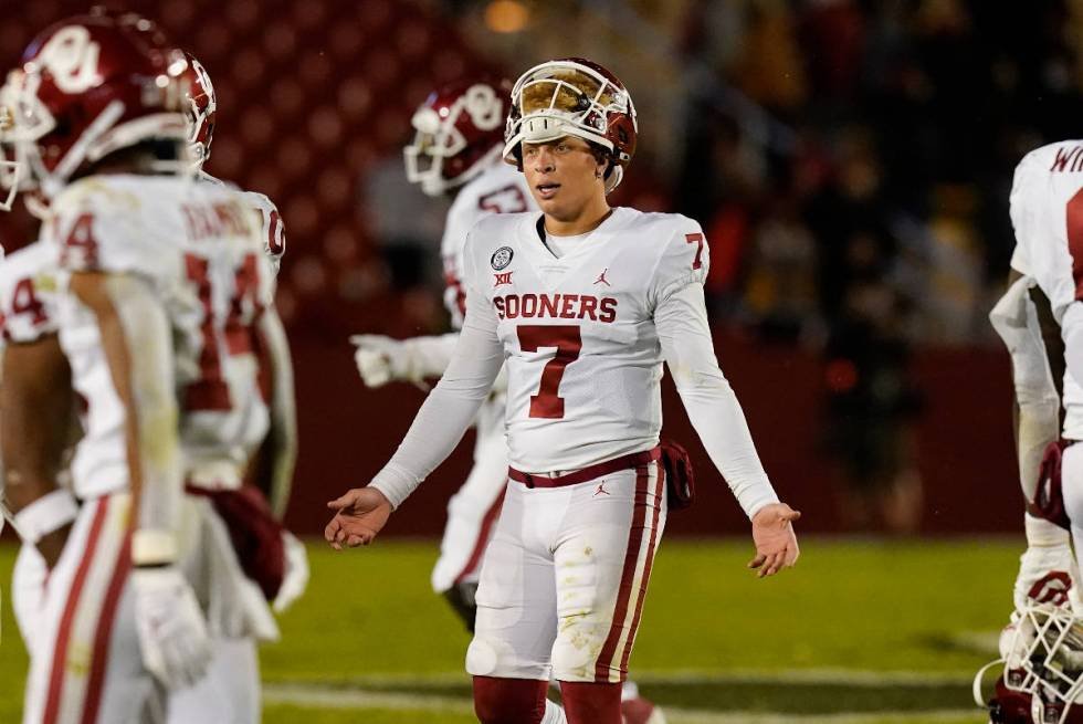 Oklahoma quarterback Spencer Rattler (7) reacts after throwing an interception during the secon ...