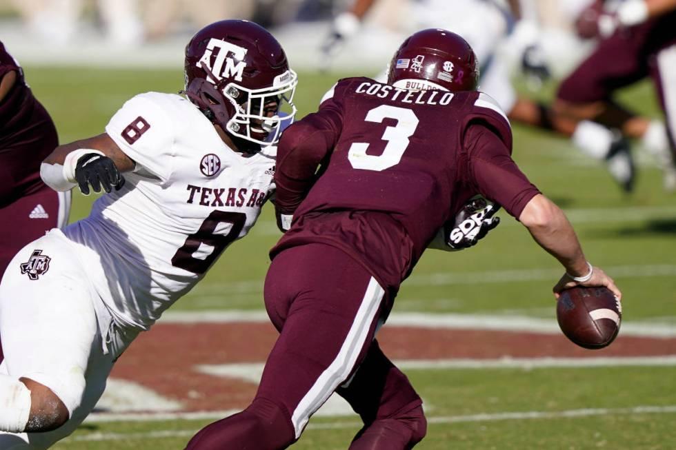 Texas A&M defensive lineman DeMarvin Leal (8) sacks Mississippi State quarterback K.J. Costello ...