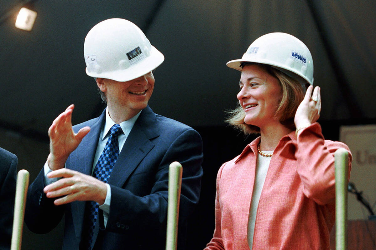 FILE - In this May 4, 2001, file photo, Microsoft Chairman Bill Gates contends with an ill-fitt ...