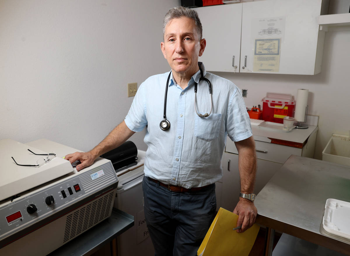 Henderson pediatrician Dr. Michael Levin Monday, May 3, 2021, with the centrifuge he will use i ...