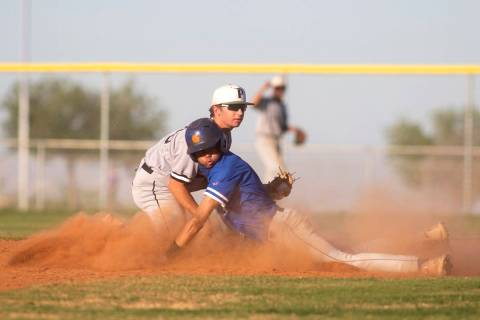 Bishop Gorman's Justin Crawford (3) slides into second on an attempted steal while Palo Verde's ...