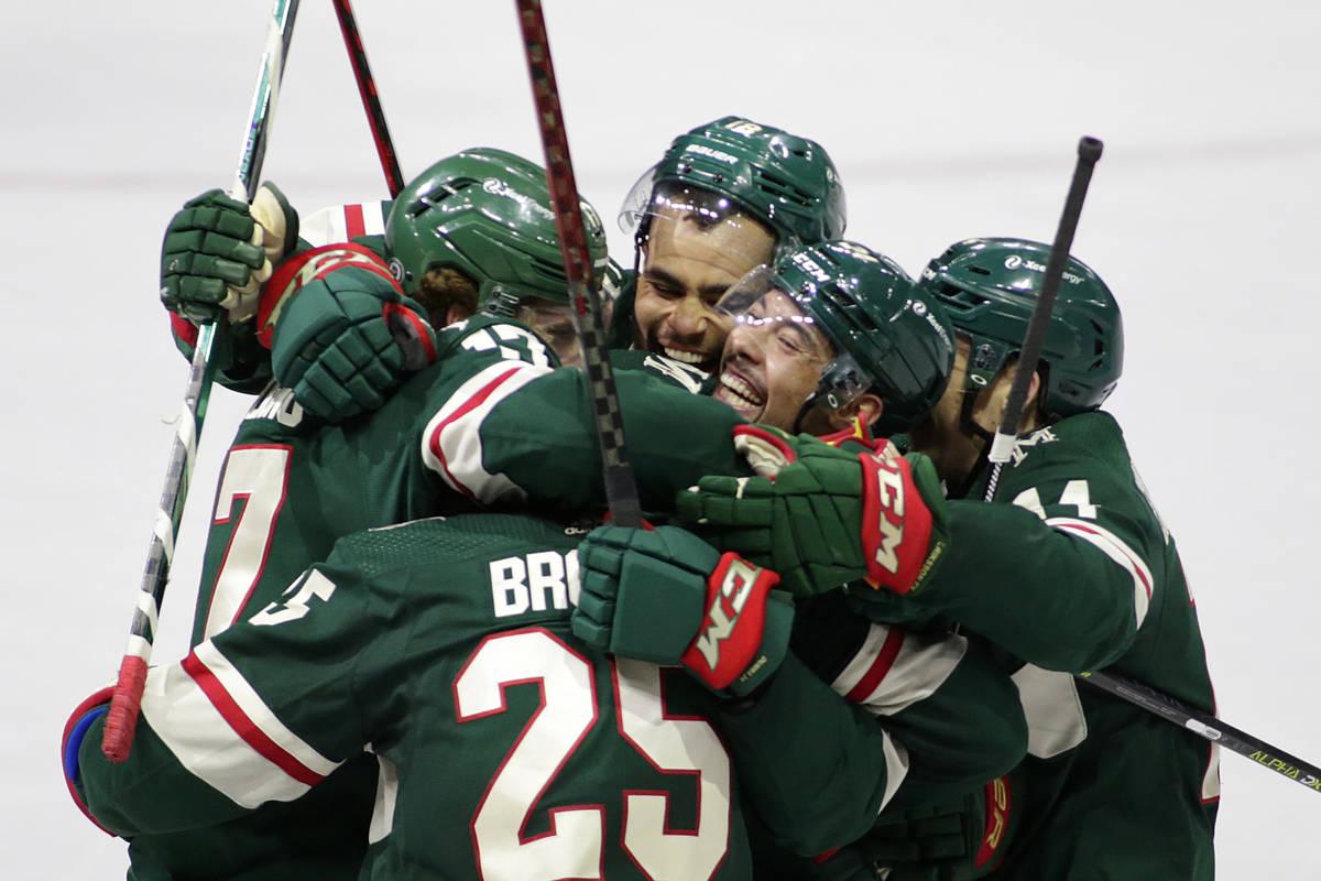 Minnesota Wild defenseman Jonas Brodin (25) is congratulated by teammates Minnesota Wild left w ...
