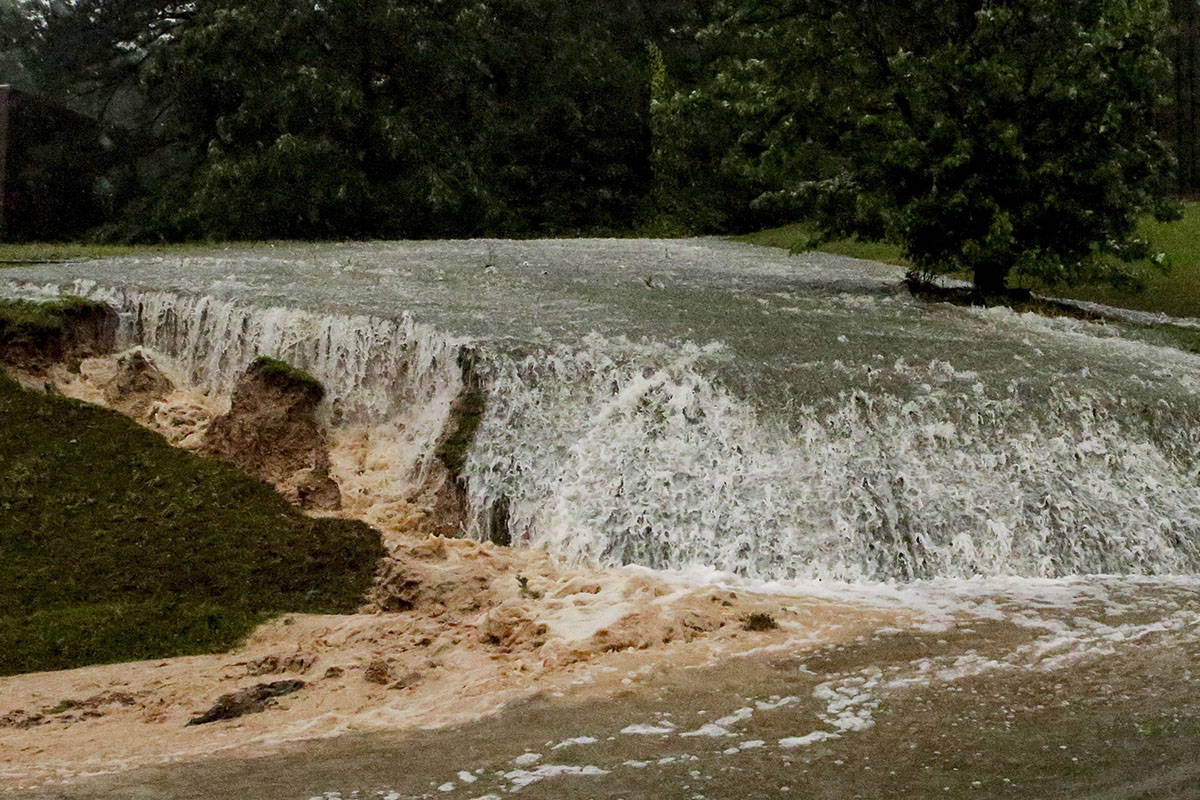 A hillside is eroded away as torrential rainfall falls Tuesday, May 4, 2021 in Vestavia, Ala. ( ...