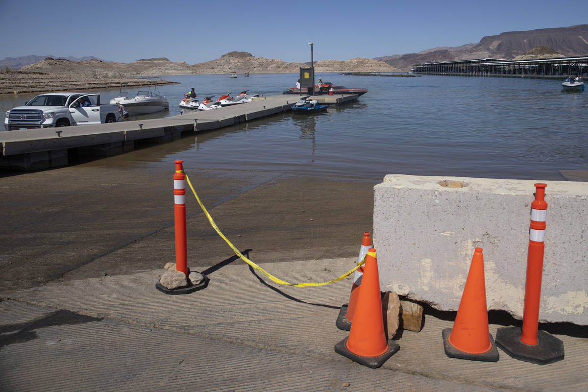 Oranges cones sit near shallow water at the Hemenway Harbor in Boulder City, Wednesday, May 5, ...