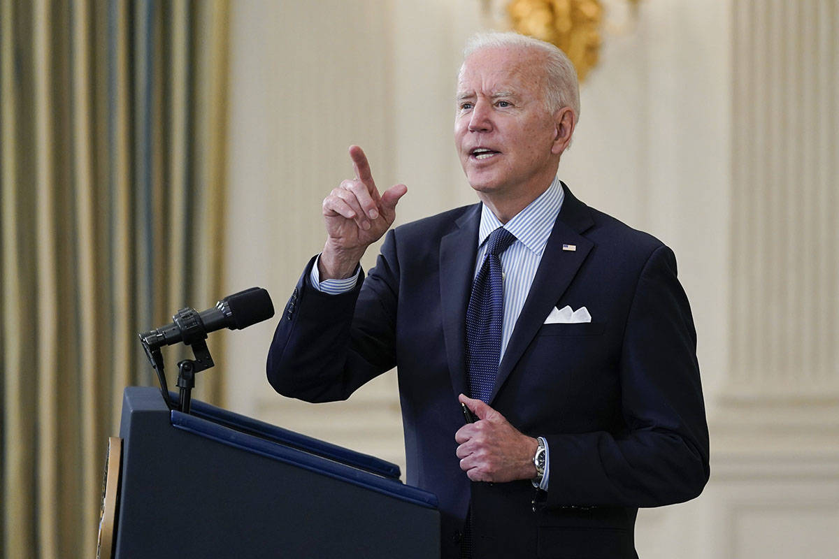 President Joe Biden takes questions from reporters as he speaks about the COVID-19 vaccination ...