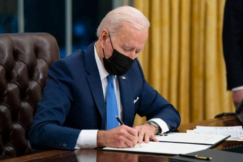 President Joe Biden signs an executive order. (AP Photo/Evan Vucci, File)