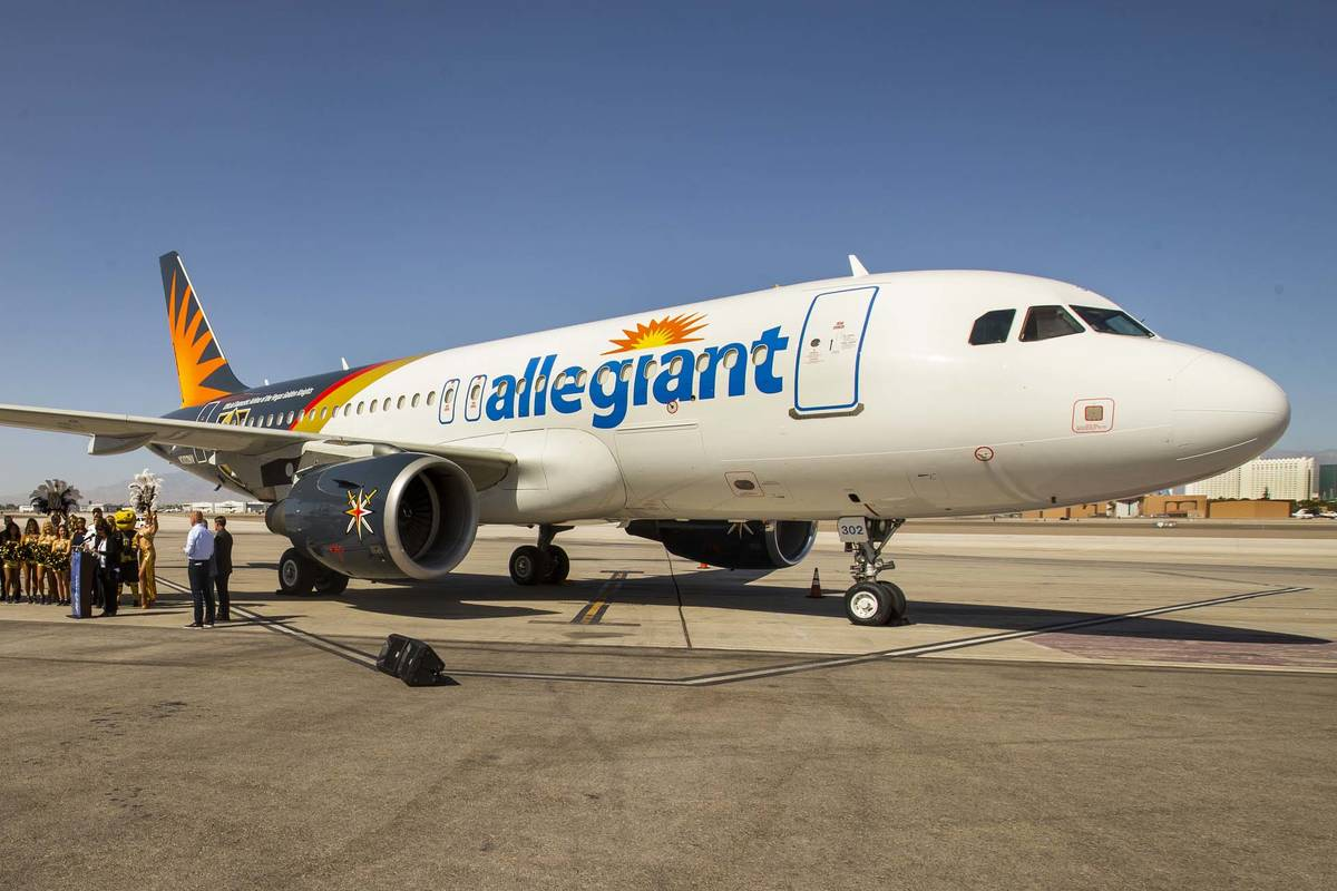 Dignitaries and team members gather as Allegiant unveils a new Golden Knights-themed plane at M ...
