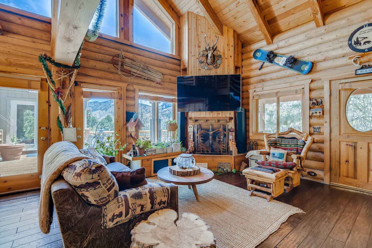 The family room of 4947 Snow White Road. (Virtuance)