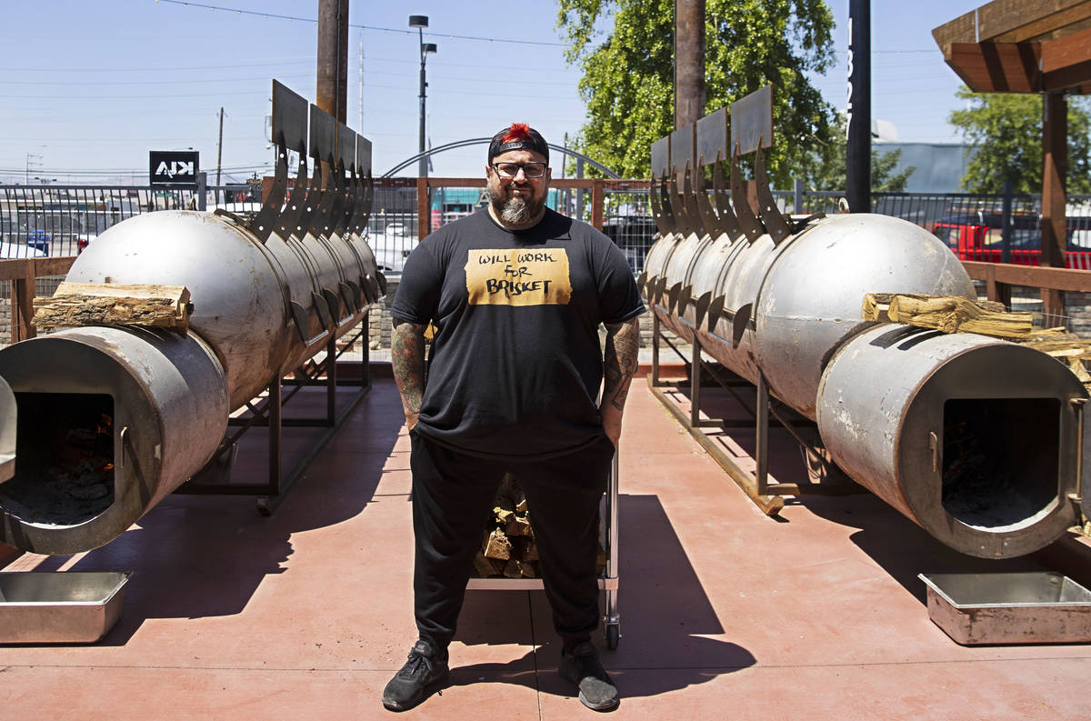 Bruce Kalman, chef and owner of Soulbelly BBQ, Arts District BBQ spot, poses for a photo in fro ...